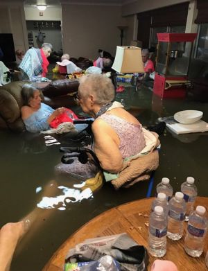 Fifteen Nursing Home residents of La Vita Bella in Dickinson South Houston, sit in waist deep  water before they were air lifted by helicopter to safety. Photo:Timothy McIntosh