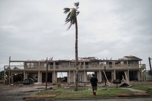 Osman Harr surveys the damage to an apartment complex across from his own apartment in Rockport, Texas, Aug. 27, 2017. At least five deaths and more than a dozen injuries were reported by Sunday morning in the aftermath of Harvey, the hurricane that tore across the Gulf Coast of Texas starting Friday. (Tamir Kalifa/The New York Times)