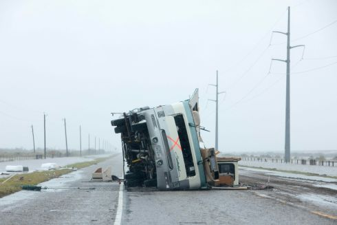 A motorhome lies flipped on it's side near Victoria, Texas in the aftermath of Hurricane Harvey on August 26, 2017.  / AFP PHOTO / Daniel KRAMERDANIEL KRAMER/AFP/Getty Images