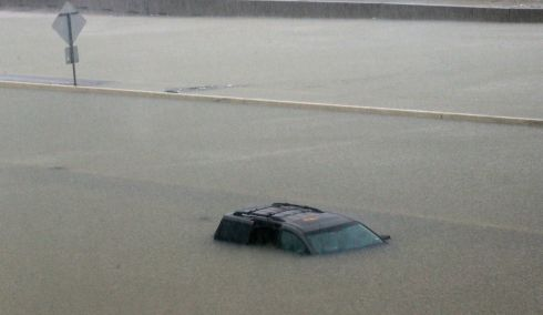 An abandoned vehicle sits in flood waters on the I-10 highway in Houston, Texas, Sunday, Aug. 27, 2017. (AP Photo/LM Otero)