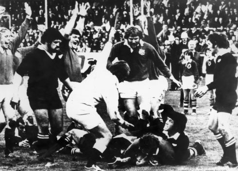 1977:  Willie Duggan scoring for the Lions in a match they lost to the All Blacks 19-7 at Dunedin, New Zealand. The cheering Lions are (left to right) Peter Wheeler, Fran Cotton and Derek Quinell.  Photograph: Getty Images
