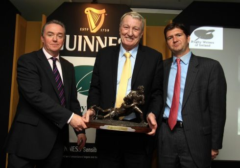 2010:  Rugby Writers of Ireland Awards  -- Willie Duggan receives the Hall of Fame award from   journalist Brendan Fanning  and Oliver Loomes of Diageo. Photograph: Dan Sheridan