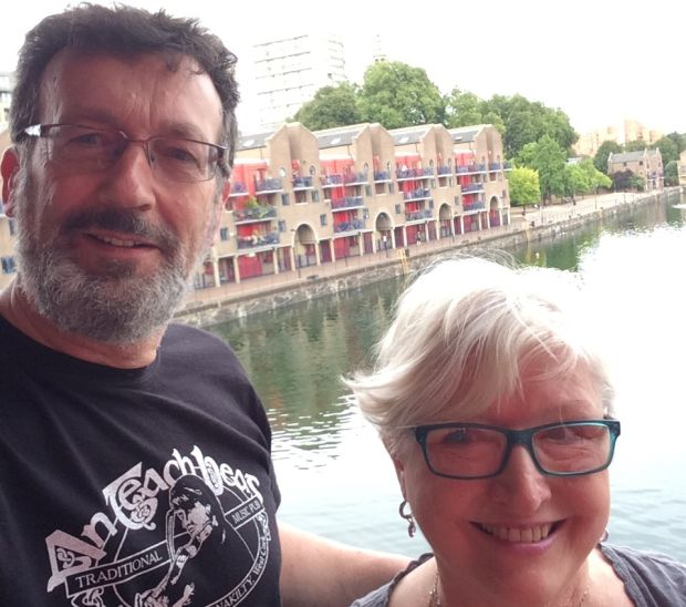 Greta Kelly and her husband Shane Minogue on the balcony of their apartment overlooking the Shadwell Basin in Wapping. They commute regularly between London and Cork.