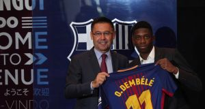 FC Barcelona's new signing Ousmane Dembele with president Josep Maria Bartomeu. Photo: Albert Gea/Reuters