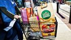 Amazon.com spent its first day as the owner of a brick-and-mortar grocery chain cutting prices at Whole Foods Market.