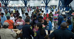Flood victims gather for food at a shelter in the George R Brown Convention Centre, in Houston, Texas, the US. Photograph: Brendan Smialowski/AFP/Getty Images