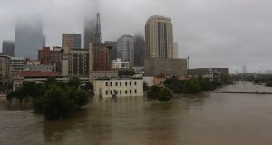 Flood waters flow in the Buffalo Bayou in downtown Houston, Texas, the US. Photograph: LM Otero/AP Photo
