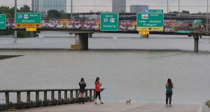 People view the flooded highways in Houston, Texas, the US. Photograph: Thomas B Shea/AFP/Getty Images