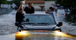 Residents use a truck to navigate  flood waters  in Houston, Texas, US. Photograph: Adrees Latif/Reuters