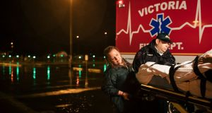 Jami Leifeste, an emergency medical technician, is helped by a co-worker as they evacuate a patient from Citizens Medical Center to another hospital, in Victoria, Texas. Photograph: Alyssa Schukar/New York Times