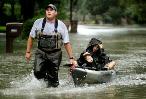 WASHED OUT: People evacuate a neighbourhood inundated by flood waters from Tropical Storm Harvey, in Houston, Texas. Photograph: Charlie Riedel/AP