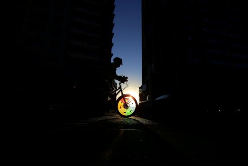 INTO THE LIGHT: A cyclist in Sydney's business district in Australia. Photograph: Steven Saphore/Reuters
