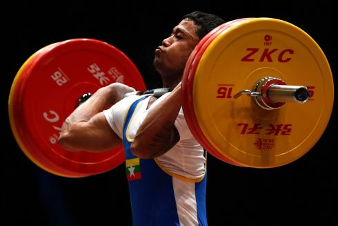 CLEAN AND JERK: Myint Kyi of Myanmar in action during the Men's - 62kg weightlifting event at the Southeast Asian Games Kuala Lumpur 2017 in Malaysia. Photograph: Fazry Ismail/EPA