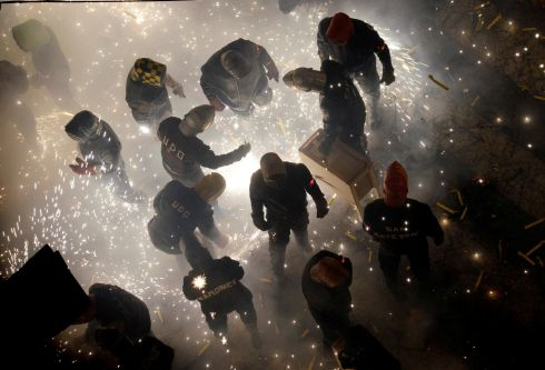 "CORDA CARNIVAL: Revellers play with fireworks during the annual ""Corda"" festival in the village of Paterna near Valencia, Spain. Photograph: Heino Kalis/Reuters"