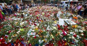 Flowers and candles are placed in tribute to victims of the recent terrorist attack in Las Ramblas,  Barcelona, Spain. Photograph:  Alejandro Garcia/EPA