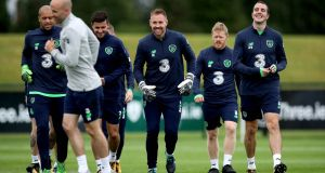 Shane Long, Rob Elliott, Daryl Horgan and John O'Shea in good spirits during the Republic of Ireland squad training session  in Dublin. Photograph: Ryan Byrne/Inpho