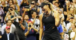 Maria Sharapova reacts after beating Simona Halep in her opening game of the US Open at Flushing Meadows, New York. Photo: Elsa/Getty Images