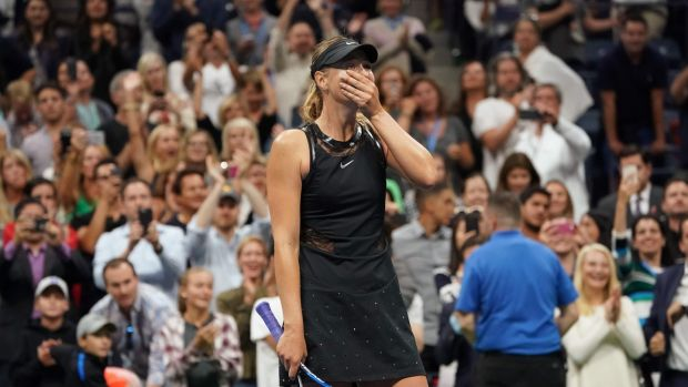 Maria Sharapova reacts after beating Simona Halep in her opening game of the US Open at Flushing Meadows, New York. Photo: Don Emmert/Getty Images