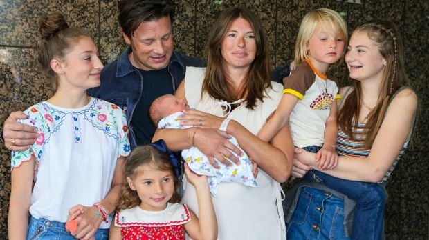 Jamie Oliver, Jools Oliver and their family pose with their new baby last year at the Portland Street Hospital in London