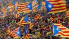 "People hold Catalan separatist flags on Catalonia day ""Diada"" in central Barcelona in 2014. Photograph: Albert Gea/Reuters"
