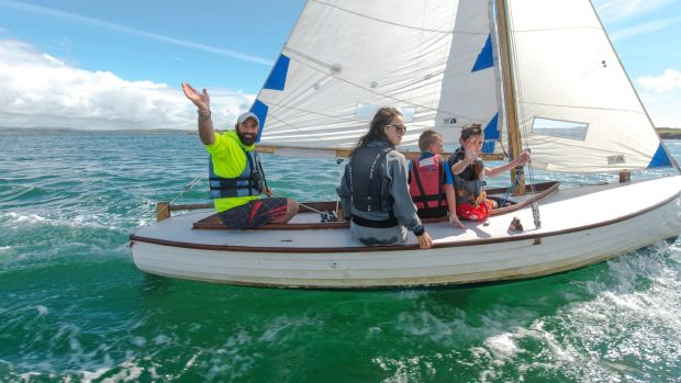 Kevin McCormack on a boat with young sailing students, off Heir Island. Photograph: Michael Mac Sweeney/Provision