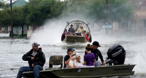 People are rescued from flood waters from Hurricane Harvey on an air boat in Dickinson,Texas. Photo:  Reuters