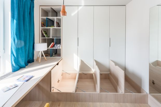 Built-in floor storage in a 42sq m (138sq ft) apartment in Prague. Photograph: Radu Sandovici Vertizontal Photography