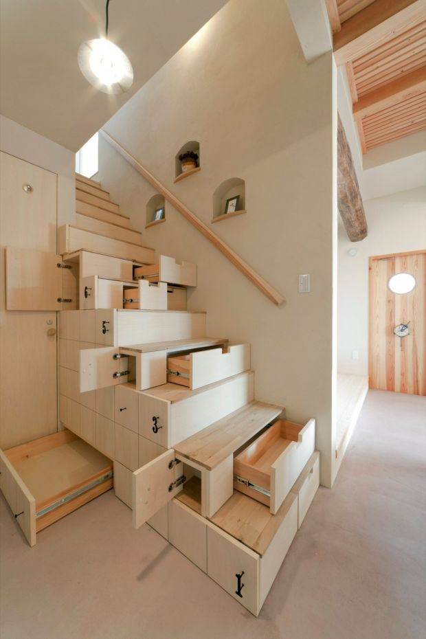 In this open-plan space in Koriyama, Japan, architect Kotaro Anzai has combined storage with a staircase