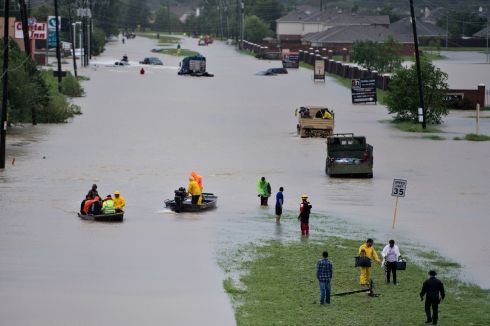 HURRICANE AFTERMATH: Volunteer rescuers evacuate people from a flooded residential area in the aftermath of Hurricane Harvey in Houston, Texas. Brendan Smialowski/AFP/Getty Images
