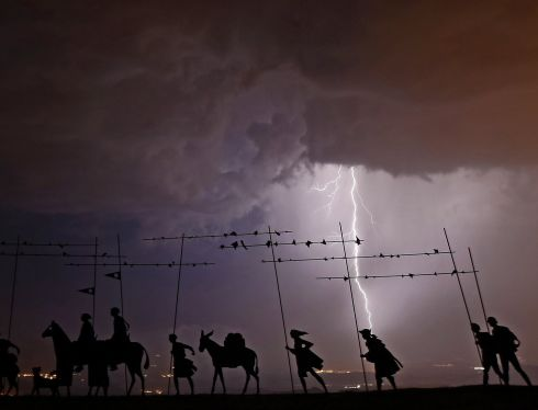 CAMINO STORM: Lighting strikes close to a sculpture of pilgrims, Alto Del Perdon, during a storm over the Camino de Santiago route, near Pamplona, Navarra, Spain. Photograph: Jesus Diges/EPA