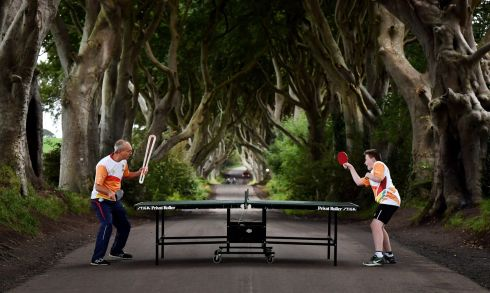 DARK HEDGES: Local table tennis players engage on a stretch of road known as the Dark Hedges as the Queen's Baton Relay makes a short stop in Antrim, Northern Ireland. The Dark Hedges, near Stranocum, featured in season two of Game of Thrones and has become a tourist mecca. The Queen's Baton Relay is  on a UK tour ahead of the 2018 Commonwealth Games in Australia. Photograph: Charles McQuillan/Getty Images