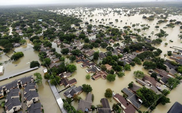 Water from Addicks reservoir flows into neighbourhoods as floodwaters from Tropical Storm Harvey rise in Houston, Texas. Photograph: David J Phillip/AP