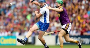 Gleeson flicks it past Matthew O'Hanlon of Wexford during their All-Ireland quarter-final. Photo: James Crombie/Inpho