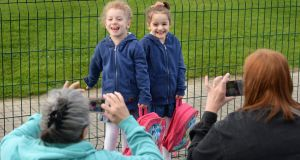 Twins Daphne and Jasmine Alecsandrescu, arriving for their first day at school in Balbriggan Educate Together. Photograph: Dara Mac Dónaill/The Irish Times