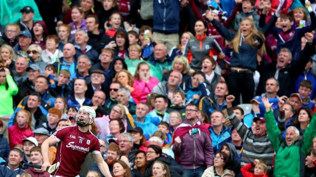 Canning watches his magnificent point go over the bar to seal Galway's place in the All-Ireland final. Photo: James Crombie/Inpho