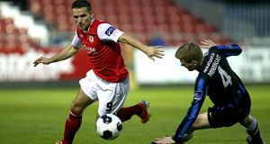 Christy Fagan  of St Patrick's Athletic's and Athlone Town's Derek Prendergast  during a League of Ireland match in 2014. Photograph: Ryan Byrne/Inpho