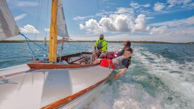 Hare Island, west Cork: Kevin McCormack with students of Heir Island Sailing School. Photograph: Michael Mac Sweeney/Provision