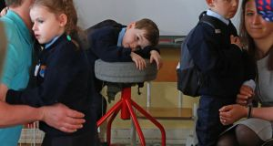 Scott Fagan having a little rest before class began on his  first day at school piece at St Olaf's NS, Balally Drive, Dundrum, Dublin 16.  Photograph: Nick Bradshaw
