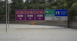The Sam Houston Tollway sits under 4.88 metres of water from flooding near the Buffalo Bayou in the aftermath of Hurricane Harvey in Houston, Texas. Photograph: Tannen Maury/EPA