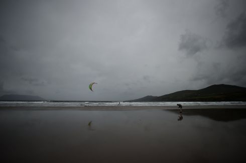 A man prepares to kite surf in the sea at Inch Beach, near the village of Anascaul in County Kerry, Ireland, July 20, 2017.