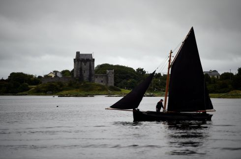 A Galway hooker boat is seen in heavy rain in the County Galway town of Kinvara, Ireland, August 20, 2017.