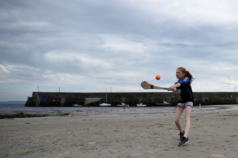 Ellie Seoige, 10, practices hurling on the beach in Spiddal, County Galway, Ireland, July 18, 2017.