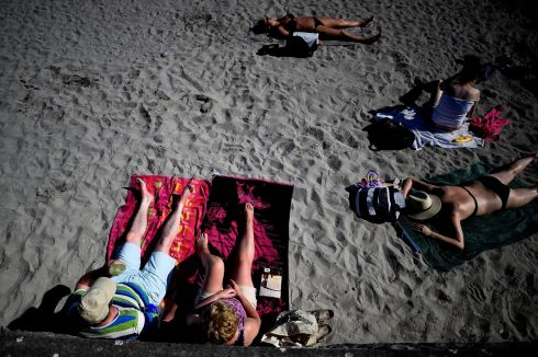 People sunbathe on the beach during good weather in Galway, Ireland, July 17, 2017.