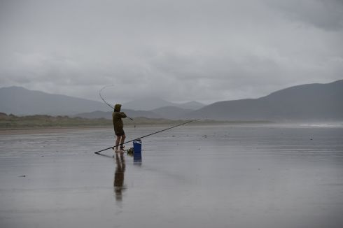 A man fishing in the rain on Inch beach in Anascaul, County Kerry, Ireland, July 20, 2017.   All photographs by Clodagh Kilcoyne/ Reuters