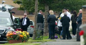 Family and friends gather outside a house on Balbutcher Drive in Ballymun before the funeral of Antoinette Corbally. Photograph:  Colin Keegan/Collins.