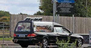A hearse carrying the coffin of  Antoinette Corbally, who was shot dead  two weeks ago in Ballymun, arrives at Dardistown Cemetery. Photograph:  Colin Keegan/ Collins.