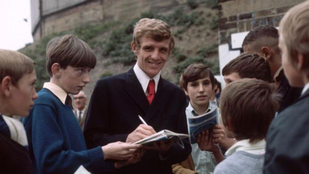 Football fans: Eamon Dunphy signs autographs outside Millwall FC around 1970. Photograph: Express/Getty