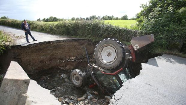 Inishowen floods: a tractor sits in a river after a road collapsed in Co Donegal this month. Photograph: Niall Carson/PA