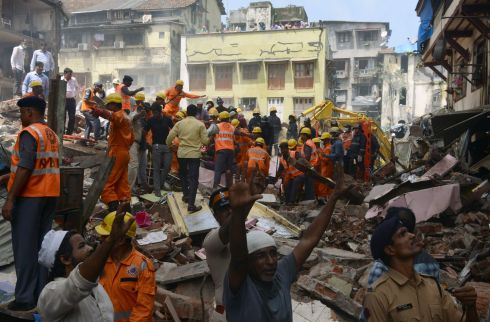 MUMBAI COLLAPSE: Rescue workers and residents look for survivors at the site of a building collapse in Mumbai, India. Photograph: Punit Paranjpe/AFP/Getty Images