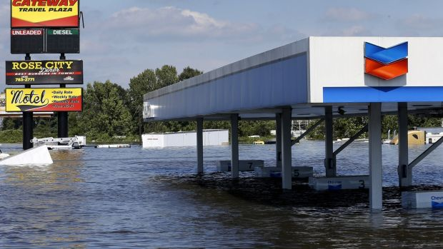 A petrol station submerged under flood waters from Tropical Storm Harvey in Rose City Texas